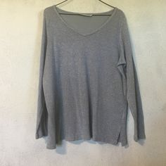 Silver sweater Cute silver sweater with bead accents around the neckline. Size is 18/20 Avenue Tops