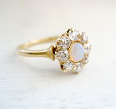 Vintage Antique Victorian Old European Cut Diamond Opal Engagement Anniversary Ring 18kt Yellow Gold Band. $599.00, via Etsy.