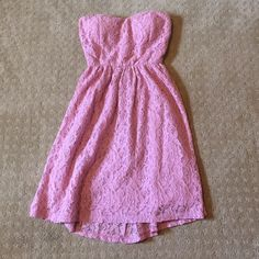 Strapless pink dress with cut out Really cute strapless pink dress with a cut out back. Has a cute bow above cut out. Like new, only worn one time. Size small. It is a little lighter pink than the pictures make it out to be. Wet Seal Dresses