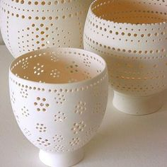 Ceramic - Candle cups. I like this idea for delicate tea cups with edging dotted out.