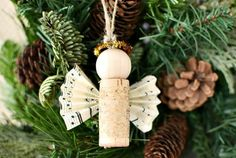 Use wine corks to make an DIY wine cork angel Christmas ornaments for your Christmas tree with sheet music wings and a gold pipe cleaner halo. Easy to make. Creative Christmas Trees, Christmas Tree Themes, Christmas Love, Best Christmas Gifts, Christmas Angels, Christmas Crafts, Christmas Ornaments, Cork Ornaments, Christmas Deco
