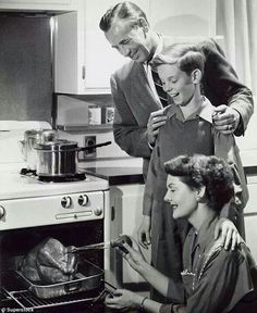 Mom bastes the turkey while Dad and son anticipate a delectable drumstick... -- (yesteryear Thanksgiving photo, vintage)