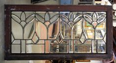 "Leaded/beveled glass window - 44"" long x 22 1/2""h $795.00"