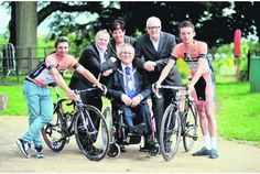 Tour of Britain launch: From left, Rico Rogers, Councillor Mark Meredith, Lady Mayoress  Linda Crowe, Lord Mayor   Terry Crowe,  Mick Bennett and Kieran Frend. Right, BMX stunt rider Norbert Onodi. http://www.thisisstaffordshire.co.uk/Cycle-race-set-fast-finish/story-16561462-detail/story.html#