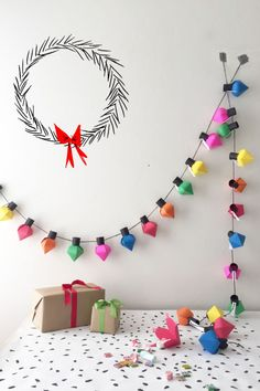 Christmas Bulb Advent Calendar Tutorial: Fill each bulb with confetti and candy for a month of fun leading up to Christmas.