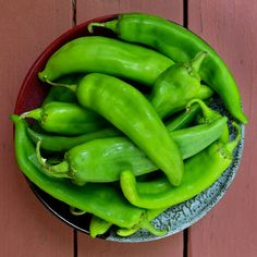 I'm visiting family in Texas this summer, and I did a triple-take upon seeing the price of green Hatch chiles from neighboring New Mexico: three pounds for a mere dollar! There are only so many chile peppers one can eat in a sitting, but that didn't stop me from buying them in bulk and roasting them to put up in my family's freezer. Like most good preserving projects, this one takes takes advantage of produce at its peak of freshness, is economical, and provides a fantastic ingredient one…