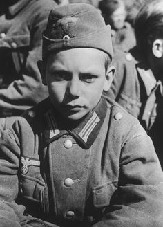 A captured 13-year-old German POW of the Hitler Youth, taken prisoner by the US Army in late spring of 1945 in the Waltenhofen region.