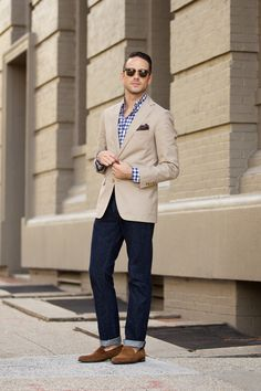 Khaki cotton blazer by Brooks Brothers Navy gingham shirt by J.Crew Dark blue slim denim jeans by J.Crew Brown silk pocket square with blue border by Brooks Brothers Sunglasses by Ray-Ban (Clubmaster) Brown suede loafers by To Boot New York