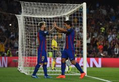 Luis Suarez of Barcelona celebretes scoring his sides seventh goal with Lionel Messi of Barcelona during the UEFA Champions League Group C match between FC Barcelona and Celtic FC at Camp Nou on September 13, 2016 in Barcelona, Catalonia.