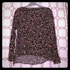 Zara blouse A more subdued play on animal print, while maintaining a chic edge. Style with black skinnies and scrappy black heels. Perfect for work or play. Zara Tops Blouses