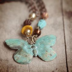 Beaded with metal butterfly.