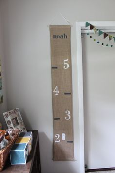 children's hanging growth chart -- burlap. $45.00, via Etsy. (DIY project)