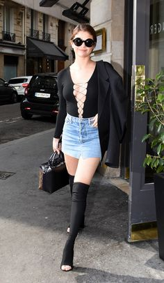 Selena Gomez looks like a dream in her thigh-high boots and a denim skirt