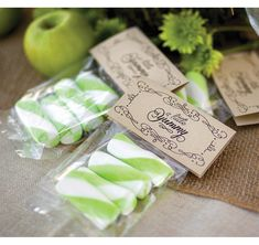 """These treat toppers have a vintage inspired design.  The words """"A Little Yummy"""" are written on each side inside a swirly design.  Printed in font shown.  Cellophane favor bags are included."""