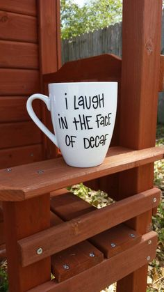 Set the record straight about decaf coffee with this funny, hand painted, large quote coffee mug! It features the saying I laugh in the face of decaf. The quote is written in black with a ceramic specific paint pen on a white 16 ounce porcelain coffee mug.  This mug has been cured to be dish washer safe but hand washing with warm water and a non abrasive cleaner is strongly suggested. Do NOT microwave or soak.  If you would like to personalize this mug with a name, nickname or monogram on…