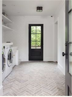 White Laundry Room with Faded Red Brick Herringbone Floor - Transitional - Laundry Room White Laundry Rooms, Mudroom Laundry Room, Farmhouse Laundry Room, Laundry Room Design, Laundry Room Floors, Farmhouse Flooring, Small Laundry, Brick Tile Floor, Herringbone Tile Floors