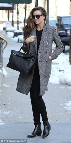 Miranda Kerr wearing Frame Denim Le Luxe Noir Stretch-Satin Twill Skinny Jeans SAINT LAURENT 40MM SL ROCK LOW BOOTS SAINT LAURENT double breasted coat Hermes Kelly Bag