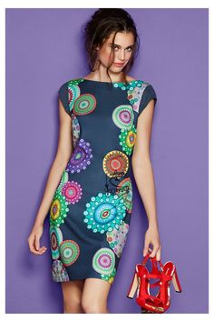 Desigual Short pinafore dress with a colorful pattern. Discover the spring-summer 2016 collection!