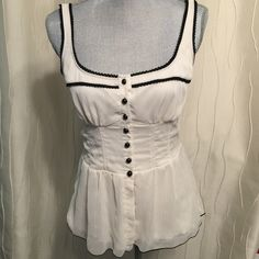 Ivory Chiffon Peplum Ivory peplum with black trim and buttons. Chiffon so can dress it up or down. Wet Seal Tops