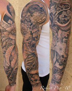 Japanese style tattoo sleeve with tiger and snake