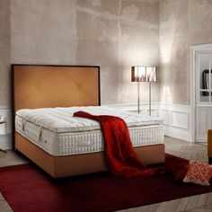CARAT BRUT has a slim wooden surrounding frame. Paris, Bed Head, Made In France, Interior S, Luxurious Bedrooms, Showroom, Mattress, Luxury, Komfort