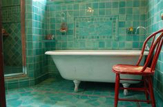 Turquoise and red=great combo  i really love the tiles (minus the fish)    www.filmoreclark.com