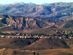 The city of Simi Valley is surrounded by the Santa Susana Mountain range and the Simi Hills, west of the San Fernando Valley and east of the Conejo Valley.  It is a wonderful place to live.