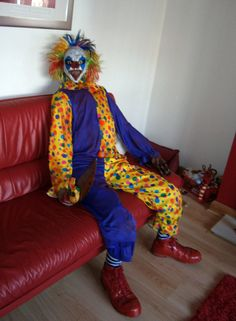 I like the idea of having a creepy clown just sitting on the couch at a haunted carnival party.