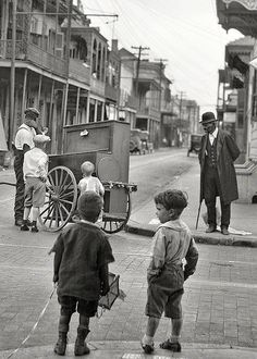 """Bourbon Street and Ursulines Avenue circa 1925. """"New Orleans organ grinder."""" Nitrate negative by Arnold Genthe"""