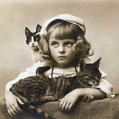 Famous cats from the turn of the century.  Sadly their names are long forgotten.  The girl never received her royalties and died penniless...