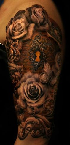 #Keyhole #tattoo with #roses. The color choice is so subtle, yet so powerful.