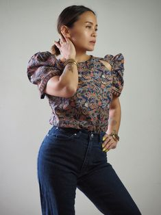 A VINTA bestseller, this Filipiniana terno top has saucy little cut-outs at the front shoulder. Made with Philippine batik printed poly-cotton blend. Filipiniana, Batik Prints, Modern Fashion, Midnight Blue, Mom Jeans, Ready To Wear, Ruffle Blouse, How To Wear, Gallery