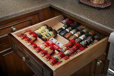 organized spices in a kitchen drawer
