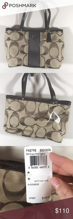 """NWT coach purse Inside zip, cell phone and multifunction pockets  Dogleash-clip closure, fabric lining  Handles with 5 1/2"""" drop  11"""" (L) x 7"""" (H) x 3 1/4"""" (W) Coach Bags Mini Bags"""