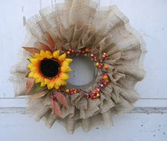 Tutorial: Simple Burlap Wreath:  20 North Ora - Directions for a different type of burlap wreath. Personalize w different center arrangements.