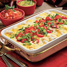 Breakfast Enchiladas | Enjoy the make-ahead ease of this casserole. Prepare the recipe, without baking, and refrigerate overnight. | http://SouthernLiving.com