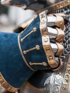 Armstreet Armoury hourglass gauntlet from their king's guard kit. The brass details and Latin mottos are particularly nice.
