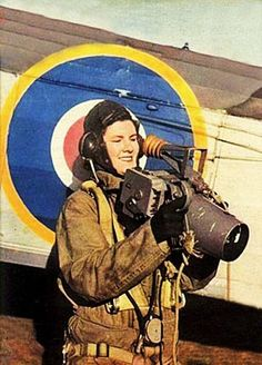 WRENS (Womens Royal Naval Service) of the Fleet Air Arm, peformed a multitude of tasks during World War 2. Here a WREN is loading  a camera onto a Fairy Swordfish. 1943