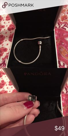 Pandora Silver bracelet authentic! Tons of charms! Selling my 3 full pandora bracelets. This is the silver one in preowned condition. Let me know if you're looking for any charms I may have them. Horse, cow, letter A, Christmas tree, luggage, graduation, heart, horse shoe, sheep, elephant, flowers, more hearts, various charm stoppers, butterflies, chicken, sleigh, books, daughter heart, more flowers, more hearts, airplane! Let me know if you'd like to see pictures of any of these. Also…