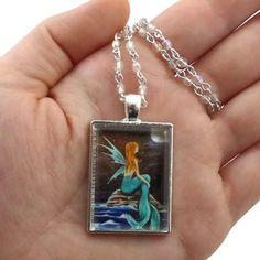RE-PIN: Do you wish you were a mermaid under the light of a full moon? Let Serenity take you to sea. Click the link in my bio to shop #FantasyArtPendants #ByKKSwann feat. @DrakeyArt!  ### #feedyourwhimsy #drakeyart #fantasyart #fantasyartnecklace #necklace #handmadenecklace #designernecklace #mermaid #fairy #fairymermaid #fullmoon #mermaidnecklace #mermaidjewelry #mermaidart #fairyart #fairynecklace bykkswann.com/shop/