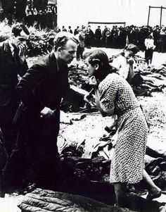 Crying citizens of Lviv in the piles of corpses of murdered people by NKVD in June 1941