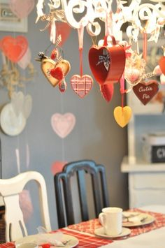 We have the perfect chandelier for this! We used different sized heart-shaped cookie cutters with different colored satin ribbon. My kids did the work, and it was a super cute way to decorate! Will do again!