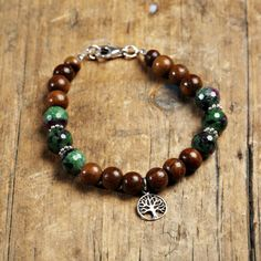 A personal favorite from my Etsy shop https://www.etsy.com/listing/267052001/fiery-ruby-zoisite-mystic-rosewood