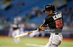 Ichiro Suzuki #51 of the Miami Marlins flies out to right field during the seventh inning of a game against the Tampa Bay Rays on September 30, 2015 at Tropicana Field in St. Petersburg, Florida.