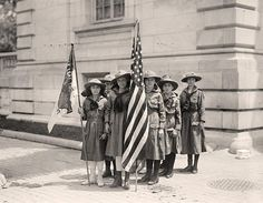 photograph of Girl Scouts. Activities and Play.  It was created in 1917 by Harris & Ewing.