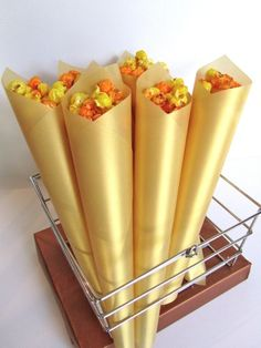 "golden popcorn cones- we could do these with 'platinum' paper, have a hollywood red carpet theme, ""you are all stars"" and show ""home videos"" - i.e. PCMA past event footage from over the years."