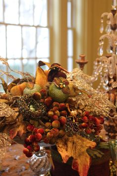 (Pinned The centerpiece, layered velvet fruits, glittered fruits, glittered nests, lace leaves and old pins to create a tapestry of color for. Thanksgiving Centerpieces, Christmas Tablescapes, Christmas Decorations, Holiday Decor, Autumn Centerpieces, Harvest Decorations, Thanksgiving Wreaths, Centerpiece Ideas, Thanksgiving Table