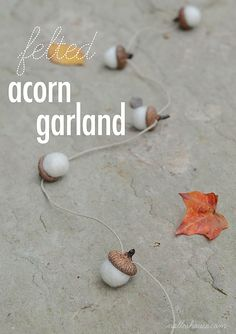 Nalle's House: Felted Acorn Garland -- Because we have that huge acorn tree in our backyard, we might as well use it to our benefit when fall comes around.