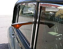 Trafficators - on old cars before flashing light indicators. My dad had a car like this - I remember pushing those in!