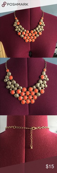Necklace This gold and orange necklace lays perfectly along your collar. Jewelry Necklaces